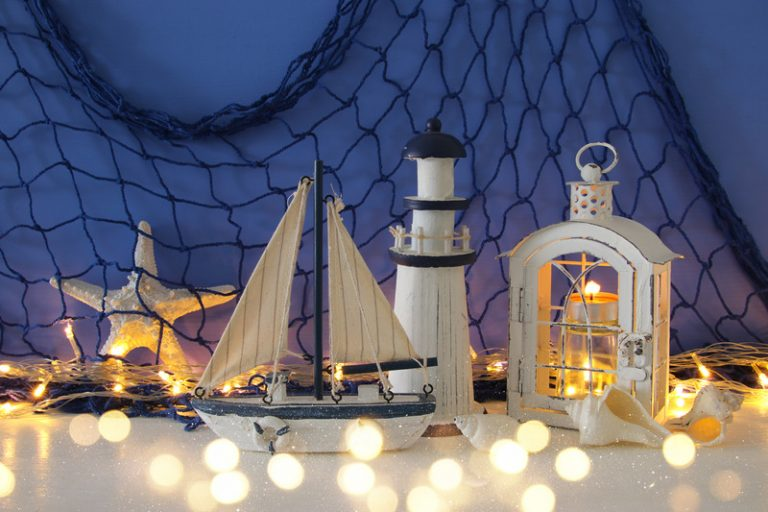 Magical Lantern With Candle Light And Wooden Boat On The Shelf. Nautical Concept