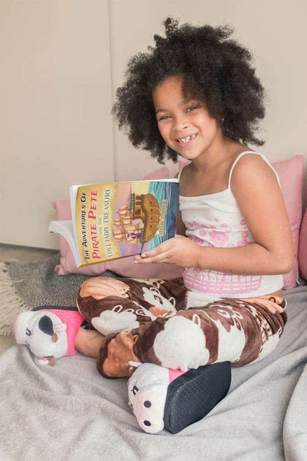 beautiful little girl reading pirate pete