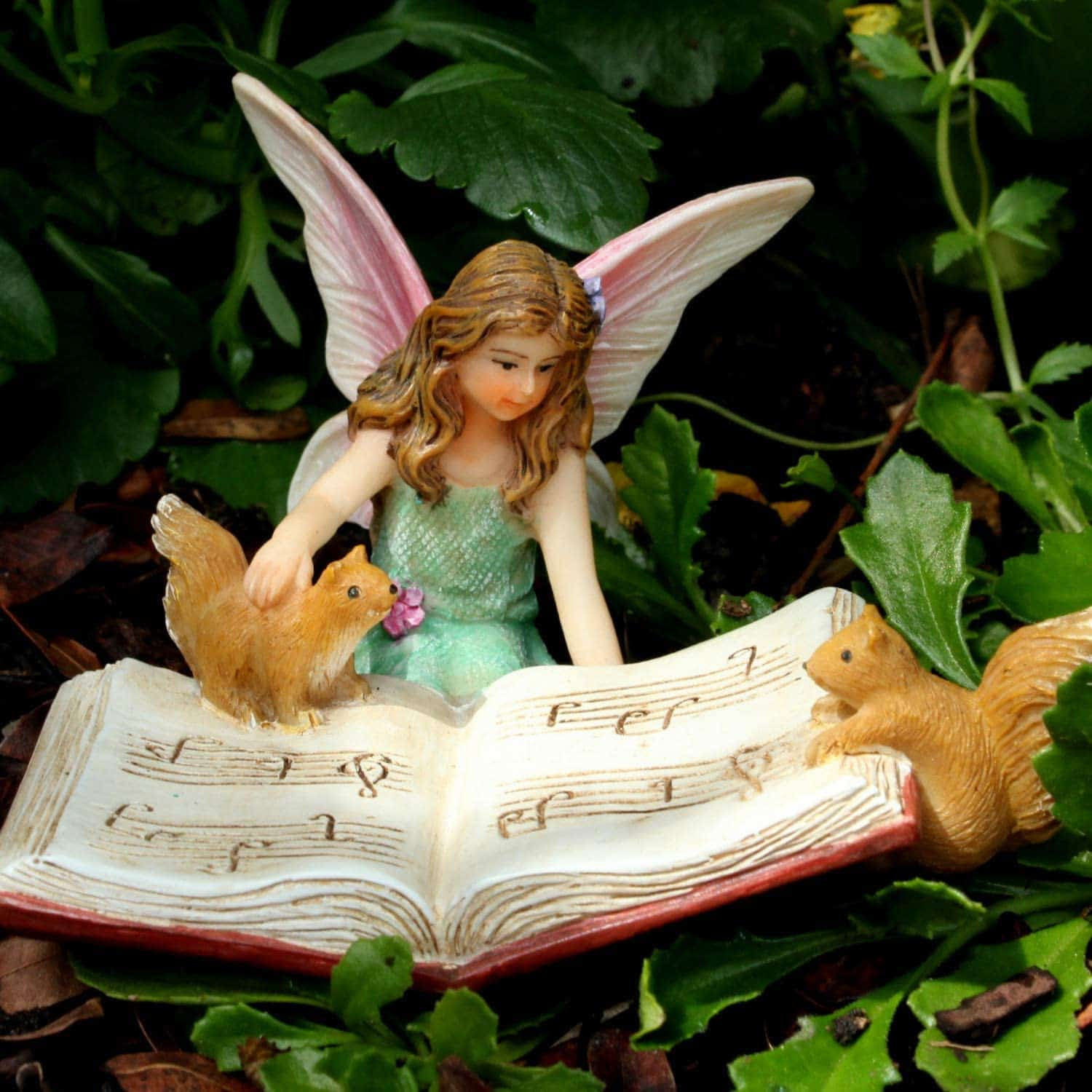Fairy and squirrels reading
