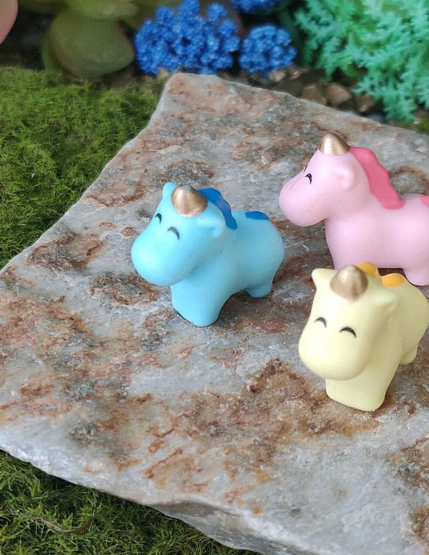 adorable pastel unicorns with smiley eyes